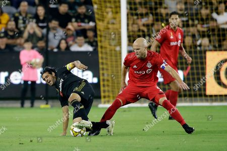 Carlos Vela, Michael Bradley. Los Angeles FC's Carlos Vela, left, is defended by Toronto FC's Michael Bradley during the first half of an MLS soccer match, in Los Angeles