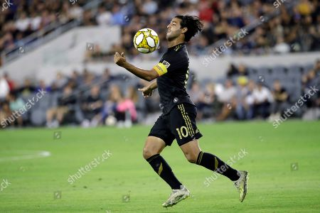 Los Angeles FC's Carlos Vela traps the ball with his chest during the first half of an MLS soccer match against Toronto FC, in Los Angeles