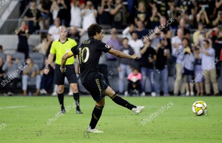 Los Angeles FC's Carlos Vela scores on a penalty kick against Toronto FC during the second half of an MLS soccer match, in Los Angeles