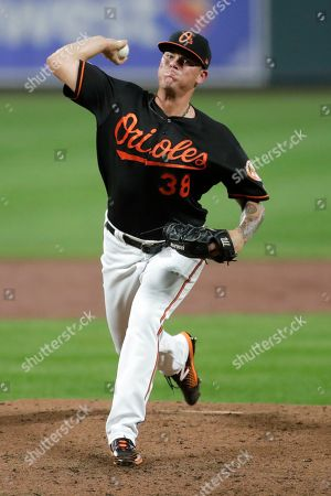 Baltimore Orioles pitcher Aaron Brooks throws a pitch to a Seattle Mariners batter during the third inning of a baseball game, in Baltimore