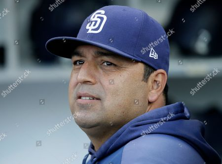 San Diego Padres interim manager Rod Barajas, right, looks over from the dugout before a baseball game against the Arizona Diamondbacks in San Diego