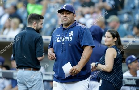 San Diego Padres interim manager Rod Barajas brings out the lineup for the umpires meeting before a baseball game against the Arizona Diamondbacks in San Diego