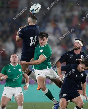 Scotland's Tommy Seymour leaps above Ireland's Jacob Stockdale to take the ball during the Rugby World Cup Pool A game at International Stadium between Ireland and Scotland in Yokohama, Japan
