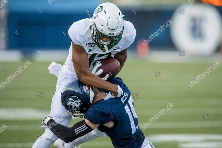 Baylor Bears wide receiver R.J. Sneed (13) is tackled by Rice Owls cornerback Andrew Bird (15) during the 1st quarter of an NCAA football game between the Baylor Bears and the Rice Owls at Rice Stadium in Houston, TX. Baylor won the game 21 to 13