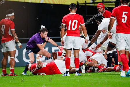 Referee Paul Williams (2-L) reviews a try during the the Rugby World Cup match between England and Tonga in Sapporo, Japan, 22 September 2019.