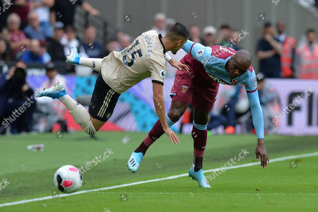 Angelo Ogbonna of West Ham United tackles Andreas Pereira during West Ham United vs Manchester United, Premier League Football at The London Stadium on 22nd September 2019