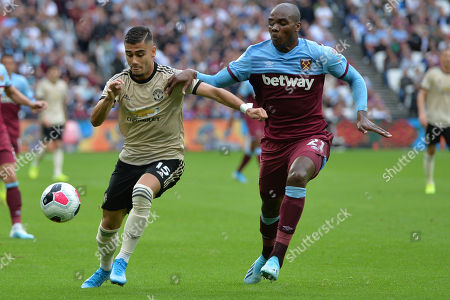 Andreas Pereira and Angelo Ogbonna of West Ham United during West Ham United vs Manchester United, Premier League Football at The London Stadium on 22nd September 2019