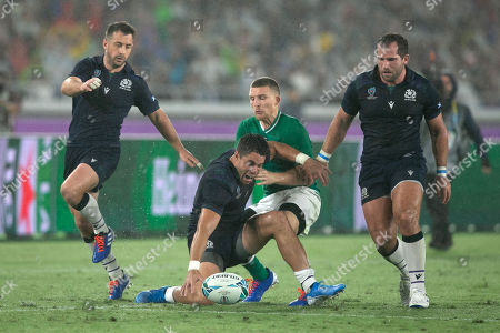 Sean Maitland - Scotland winger is challenged by opposite number Andrew Conway of Ireland as he attempts to scoop up a lose ball.