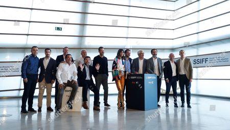 Spanish filmmakers Aitor Arregi (5-R), Jon Garano (3-R) and Jose Maria Goenaga (C) pose with cast actors Belen Cuesta (6-R), Antonio de la Torre (5-L) and Vicente Vergara (4-R), as well as producers Xabier Berzosa (L), Olmo Figueredo (3-L), Inaki Gomez (2-R), Inigo Obeso (5-R, seated), Fernando Larrondo (3-L, seated) and Miguel Menendez de Zubillaga (3-L) during the presentation of the film 'La trinchera infinita' (lit. The infinite trench) at the 67th San Sebastian International Film Festival (SSIFF), in San Sebastian, Spain, 22 September 2019. The festival runs from 20 to 28 September.