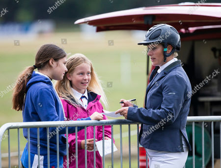Zara Tindall signing autographs and posing for pictures after the show jumping round on Watkins.