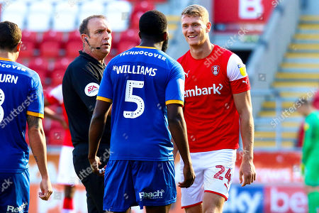 Referee Carl Boyeson attempts to get between Ro-Shaun Williams of Shrewsbury Town and Michael Smith of Rotherham United
