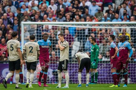 Waiting for a corner to be taken with Declan Rice (West Ham) & Angelo Ogbonna (West Ham) looking over during the Premier League match between West Ham United and Manchester United at the London Stadium, London