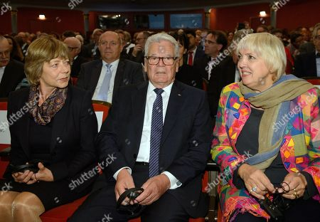 Former German President Joachim Gauck (C), his wife Daniela Schadt (L) and the vice president of the German Parliament Claudia Roth (R) take a seat at the International Nuremberg Human Rights Prize in Nuremberg, Germany, 22 September 2019. Rodrigo Mundaca receives the Human Rights Prize for his campaigns for free access to water in the Petorca region north of Santiago de Chile.