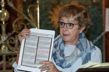 Margaret Hodge holds up far right literature circulated in her constituency which she says has been adopted by the left to attack her on social media, during a fringe event by the Jewish Labour Movement at middle Street Brighton Synagogue, during the second day of the 2019 Labour Party Conference
