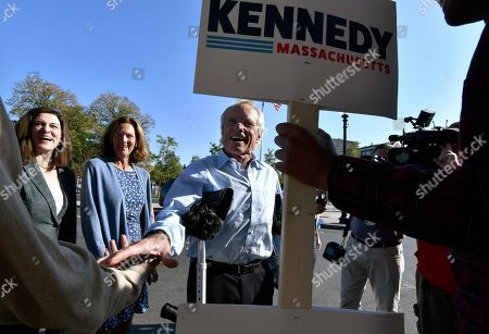 From left, Victoria Kennedy with Beth Kennedy, and her husband Former congressman Joseph Kennedy II, father of, Democratic U.S. Rep. Joseph Kennedy III, D-Mass.,greets a supporter as he arrives for their son's announcement of his candidacy for the Senate, in Boston. Kennedy will challenge incumbent Sen. Ed Markey in the Democratic primary