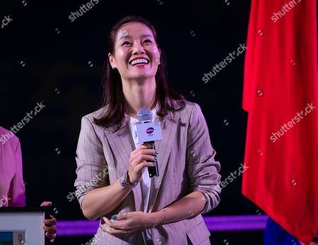 Stock Image of Li Na of China celebrating her induction into the Tennis Hall of Fame at the 2019 Dongfeng Motor Wuhan Open Premier 5 tennis tournament