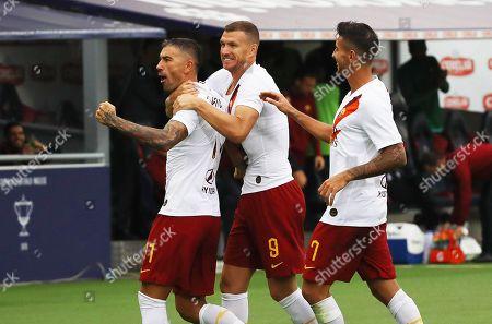 Roma's Aleksandar Kolarov (L) celebrates with teammates Edin Dzeko (C) and Lorenzo Pellegrini (R) after scoring the 1-0 lead during the Italian Serie A soccer match between Bologna FC and AS Roma in Bologna, Italy, 22 September 2019.