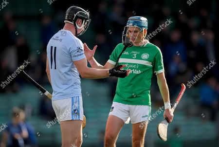 Kilmallock vs Na Piarsaigh. Na Piarsaigh's Kevin Downes with Aaron Costello of Kilmallock at the end of the game