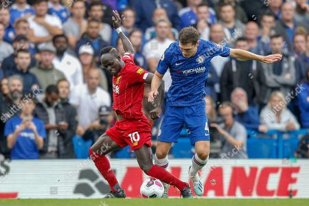 Chelsea defender Andreas Christensen (4) tackles Liverpool forward Sadio Mané (10) during the Premier League match between Chelsea and Liverpool at Stamford Bridge, London