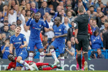 Referee Michael Oliver signals for a free kick after Chelsea defender Andreas Christensen (4) fouls Liverpool forward Sadio Mané (10) during the Premier League match between Chelsea and Liverpool at Stamford Bridge, London
