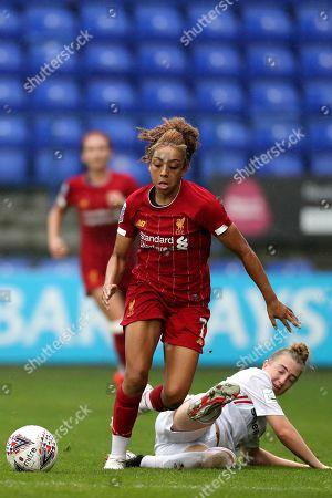 Jade Clarke of Liverpool FC Women avoids the challenge by Jade Pennock of Sheffield United Women