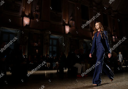 A model wears a creation as part of the Atsushi Nakashima Spring-Summer 2020 collection, unveiled during the fashion week, in Milan, Italy