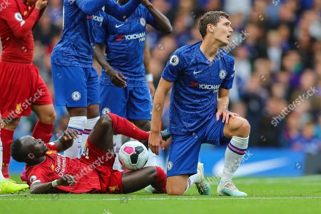 Liverpool forward Sadio Mané (10) is fouled by Chelsea defender Andreas Christensen (4) who also makes a protest to the referee during the Premier League match between Chelsea and Liverpool at Stamford Bridge, London