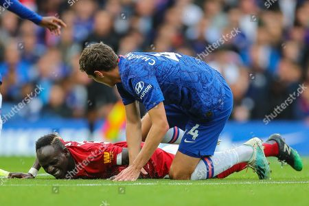 Liverpool forward Sadio Mané (10) is fouled by Chelsea defender Andreas Christensen (4) during the Premier League match between Chelsea and Liverpool at Stamford Bridge, London