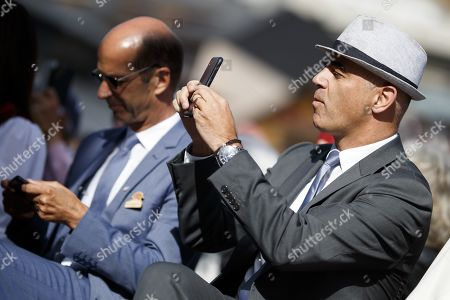 Swiss Federal Councilor Alain Berset takes pictures with his phone before he parades with some 1,500 participants during the closing parade of the Federal Festival of Traditional Music (Fete Federale de la Musique Populaire) in Crans-Montana, Switzerland, 22 September 2019. The FFMP runs from 19 to 22 September.