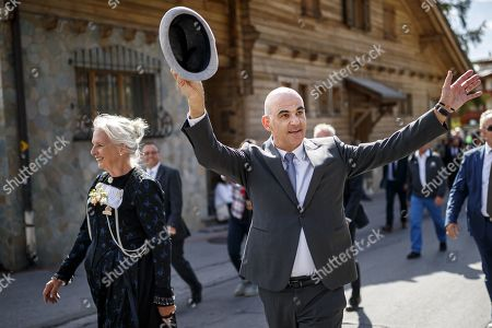Swiss Federal Councilor Alain Berset (R) waves to the crowd as he parades with some 1,500 participants during the closing parade of the Federal Festival of Traditional Music (Fete Federale de la Musique Populaire) in Crans-Montana, Switzerland, 22 September 2019. The FFMP runs from 19 to 22 September.