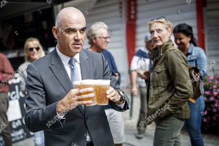 Swiss Federal Councilor Alain Berset (L) walks with beers as he attends with some 1,500 participants during the closing parade of the Federal Festival of Traditional Music (Fete Federale de la Musique Populaire) in Crans-Montana, Switzerland, 22 September 2019. The FFMP runs from 19 to 22 September.