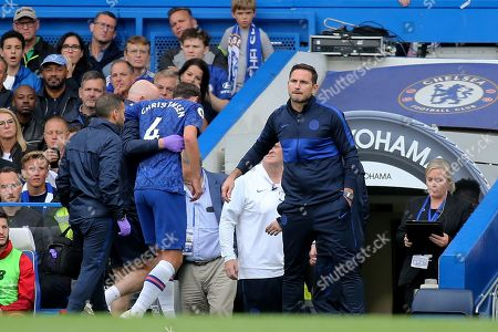Chelsea's Andreas Christensen leaves the field with an injury during Chelsea vs Liverpool, Premier League Football at Stamford Bridge on 22nd September 2019
