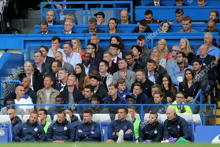 Some ex Chelsea players sit behind the home dugout, Eidur Gudjohnsen, Jimmy Floyd Hasselbaink and Emmanuel Petit (far left) look on together with Frank Lampard's wife, Christine Lampard (far right) during Chelsea vs Liverpool, Premier League Football at Stamford Bridge on 22nd September 2019