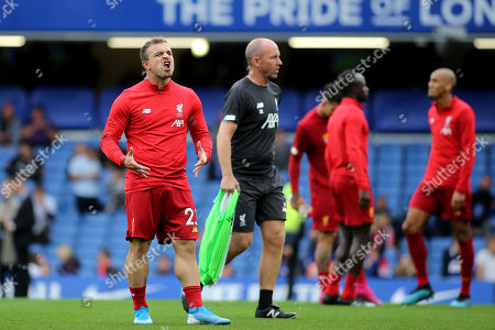 Xherdan Shaqiri of Liverpool shows his frustration as he is named as a substitute during Chelsea vs Liverpool, Premier League Football at Stamford Bridge on 22nd September 2019