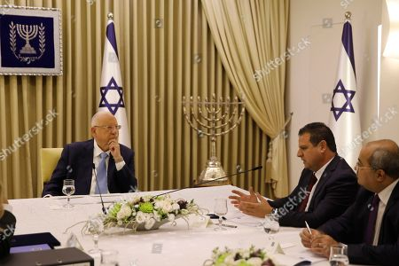 Israeli President Reuven Rivlin (L) listens to members of the Joint List Ayman Odeh (2-R) and Ahmad Tibi (R), during a consulting meeting, to decide who to task with trying to form a new government, in Jerusalem, Israel, 22 September 2019. Consultations to form the inconclusive general election, with neither Netanyahu's Likud-led coalition nor the Blue and White party, led by former military chief of staff Benny Gantz, winning enough seats to form a majority government.
