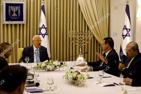 Israeli President Reuven Rivlin (2-L) listens to members of the Joint List Ayman Odeh (2-R) and Ahmad Tibi (R), during a consulting meeting, to decide who to task with trying to form a new government, in Jerusalem, Israel, 22 September 2019. Consultations to form the inconclusive general election, with neither Netanyahu's Likud-led coalition nor the Blue and White party, led by former military chief of staff Benny Gantz, winning enough seats to form a majority government.