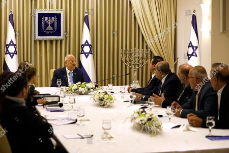 Israeli President Reuven Rivlin (C) speaks with members of the Joint List Ayman Odeh (4-R), Ahmad Tibi (3-R), Mansour Abbas (2-R) and Osama Saadi (R), during a consulting meeting, to decide who to task with trying to form a new government, in Jerusalem, Israel, 22 September 2019. Consultations to form the inconclusive general election, with neither Netanyahu's Likud-led coalition nor the Blue and White party, led by former military chief of staff Benny Gantz, winning enough seats to form a majority government.