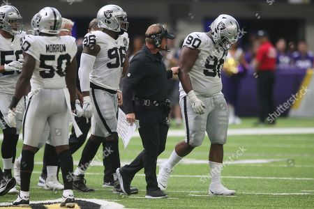 Oakland Raiders defensive tackle Johnathan Hankins (90) is helped off the field after getting injured during the first half of an NFL football game against the Minnesota Vikings, in Minneapolis