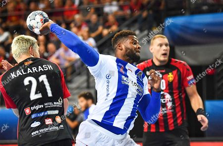 Victor Manuel Iturriza Alvarez (C) of Porto in action against Vardar players Gleb Kalarash (L) and Dainas Kristopans (R) during the EHF Champions League handball match between HC Vardar and FC Porto Sofarma in Skopje, Republic of North Macedonia, 22 September 2019.