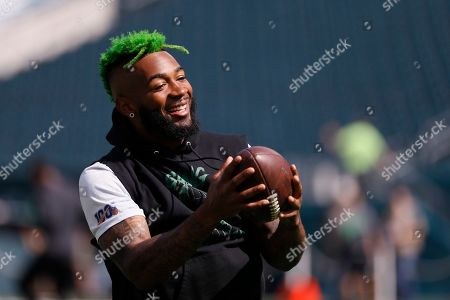 Philadelphia Eagles' Jalen Mills warms up before an NFL football game against the Detroit Lions, in Philadelphia