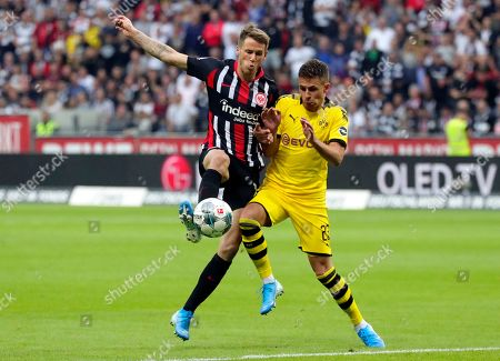 Dortmund's Thorgan Hazard (R) in action against Frankfurt's Erik Durm (L) during the German Bundesliga soccer match between Eintracht Frankfurt and Borussia Dortmund  in Frankfurt Main, Germany, 22 September 2019.