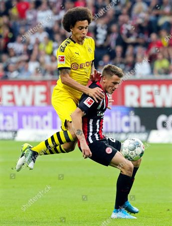 Dortmund's Axel Witsel (L) in action against Frankfurt's Erik Durm (R) during the German Bundesliga soccer match between Eintracht Frankfurt and Borussia Dortmund  in Frankfurt Main, Germany, 22 September 2019.