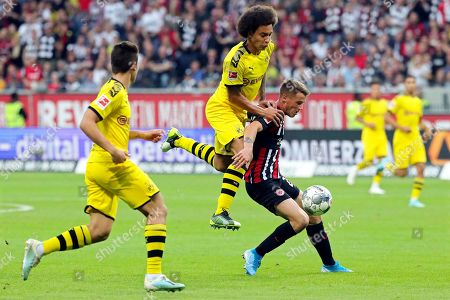 Dortmund's Axel Witsel (C) in action against Frankfurt's Erik Durm (R) during the German Bundesliga soccer match between Eintracht Frankfurt and Borussia Dortmund  in Frankfurt Main, Germany, 22 September 2019.