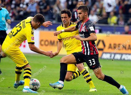 Frankfurt's Andre Silva (R) in action against Dortmund players Thorgan Hazard (L) and Thomas Delaney (C) during the German Bundesliga soccer match between Eintracht Frankfurt and Borussia Dortmund  in Frankfurt Main, Germany, 22 September 2019.