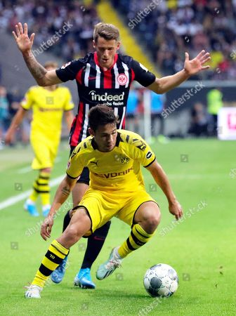 Dortmund's Raphael Guerreiro (front) in action against Frankfurt's Erik Durm (back) during the German Bundesliga soccer match between Eintracht Frankfurt and Borussia Dortmund in Frankfurt Main, Germany, 22 September 2019.