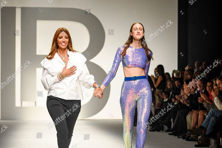 Lavinia Biagiotti and Anna Cleveland on the catwalk