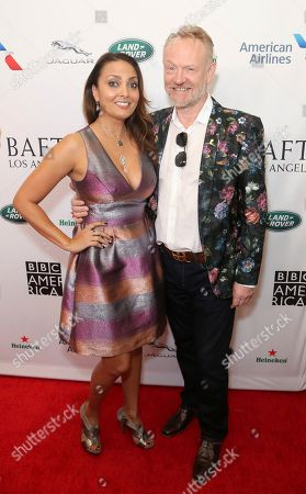 Allegra Riggio, Jared Harris. Allegra Riggio, left, and Jared Harris arrive at the 2019 Primetime Emmy Awards - BAFTA Los Angeles TV Tea Party at the Beverly Hilton, in Beverly Hills, Calif