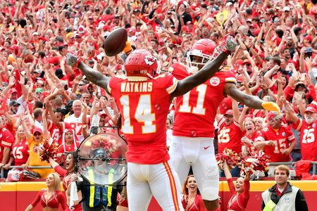 Kansas City Chiefs wide receiver Demarcus Robinson (11) celebrates his touchdown with wide receiver Sammy Watkins (14) during the first half of an NFL football game against the Baltimore Ravens in Kansas City, Mo