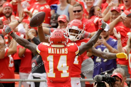 Kansas City Chiefs wide receiver Demarcus Robinson, rear, celebrates his touchdown with wide receiver Sammy Watkins (14) during the first half of an NFL football game against the Baltimore Ravens in Kansas City, Mo