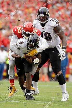 Kansas City Chiefs defensive end Frank Clark (55) sacks Baltimore Ravens quarterback Lamar Jackson (8), with offensive tackle Orlando Brown Jr. (78) watching, during the second half of an NFL football game in Kansas City, Mo